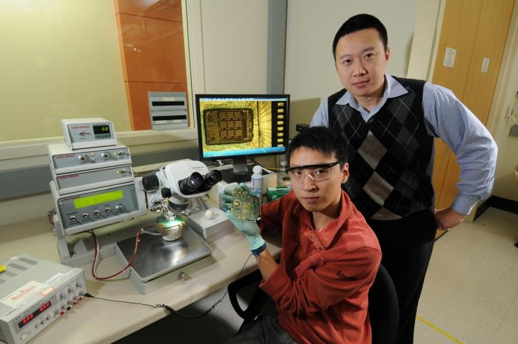 ECE Ph.D. student Taiyun Chi with his advisor Hua Wang