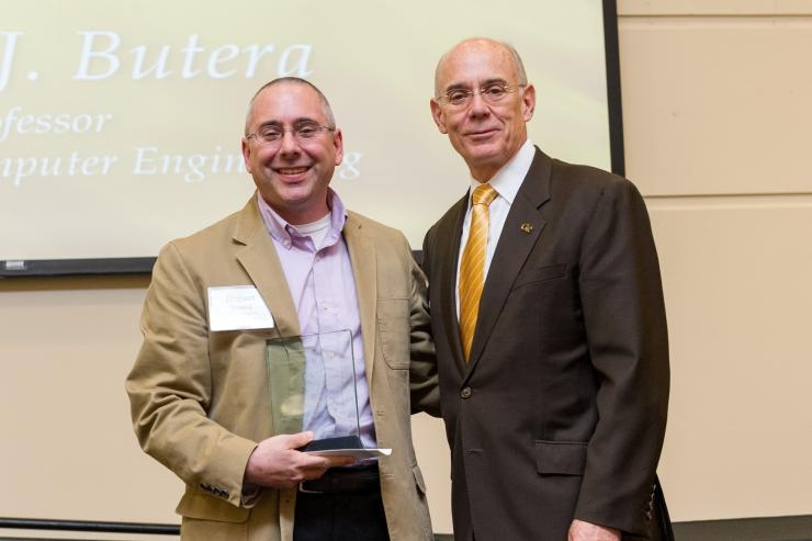 Robert Butera (L), 2016 recipient of the Senior Faculty Outstanding Undergraduate Research Mentor Award with Georgia Tech Provost Rafael L. Bras.