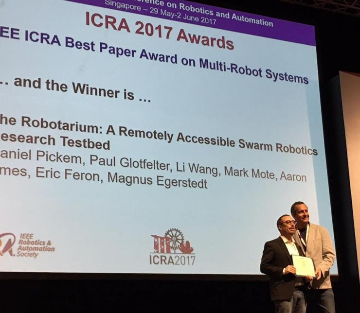 ICRA Awards Chair Martin Buss presents Best Multi-Robot Systems Paper Award to Magnus Egerstedt
