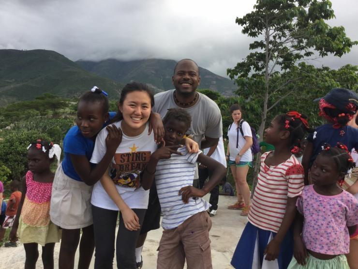 Jiaqing Li and Patrick Pierre hang with the Thoman locals.