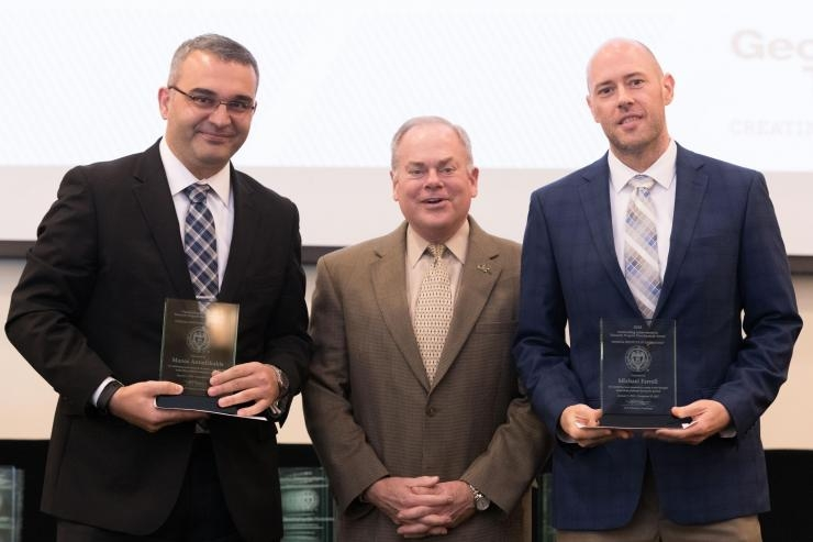 ECE Assistant Professor Manos Antonakakis and Chief Strategist GTRI CIPHER Laboratory Michael Farrell with Executive Vice President for Research Steve Cross