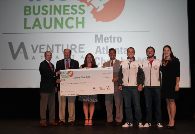 Check presentation to Gimme co-founders at the TAG Business Launch Competition.