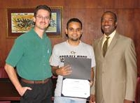 awards presentation photo of Anuj Madan, John Cres